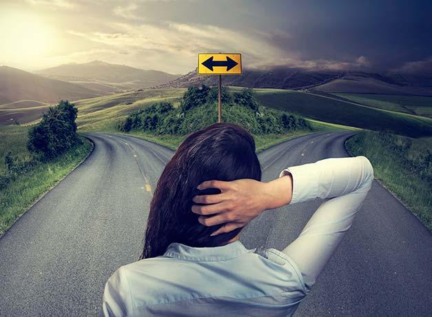 Dream scene with woman facing crossroad