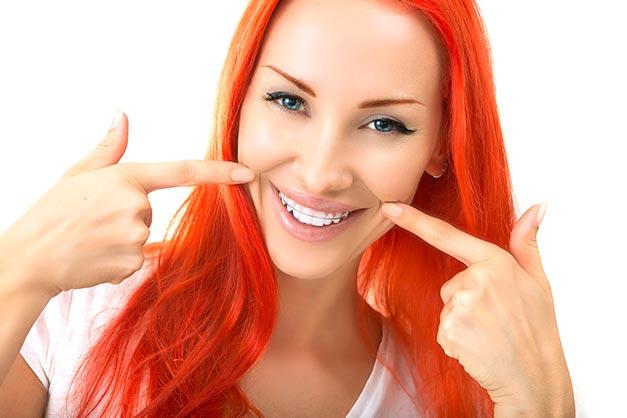 Dreamy woman showing her teeth