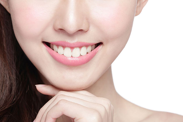 Girl with beautiful teeth that are not falling out